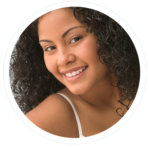 Photo of woman with straight white teeth to illustrate general and cosmetic dentistry and Invisalign by Dr. Douglas Wooddell dentist in Annandale VA near Burke, Vienna and Fairfax VA